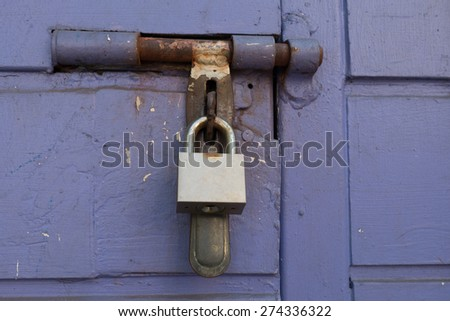 ock on purple wooden door with copy space