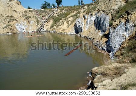 OCNA SIBIULUI, ROMANIA - JULY 9: Unidentified people swimming and floating on the water of the abandoned salt mine. On July 9, 2005 in Ocna Sibiului (Vizakna, Salzburg), Romania - stock photo