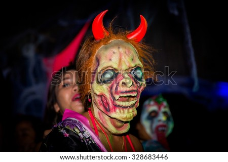 October 30, 2014 Boracay, Philippines Happy Halloween celebration on the Boracay island. Unidentified men and women wearing as vampire, witch, dead bride for Halloween. Documentary Editorial Image.
