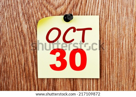 October 30 calendar. Note paper on a message board