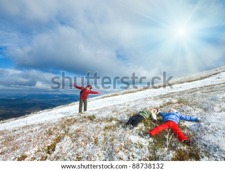 October Carpathian mountain Borghava plateau with first winter snow (and mother with children get fun) - stock photo