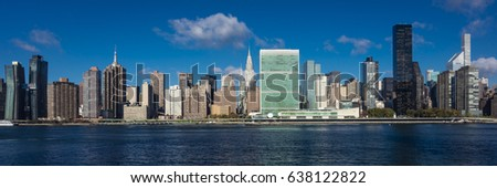 OCTOBER 24, 2016 - NEW YORK - Skyline of Midtown Manhattan seen from the East River showing the Chrysler Building and the United Nations building, New York