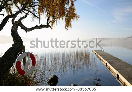October's morning on Swedish lake - stock photo
