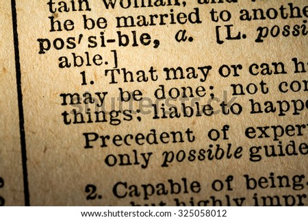 October 6th, 2015 - Montreal, Canada. Old 1945 Webster's Dictionary Macro Close-up of the word POSSIBLE and its definition on old textured yellow paper.