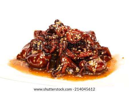 octopus salad in a spicy sauce on a white background in the restaurant