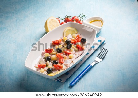 octopus salad with cherry tomatoes and black olives - stock photo