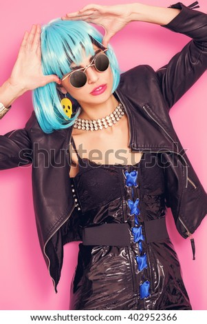 Odd girl portrait wearing blue wig and sunglasses