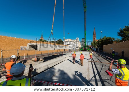 Odense, Denmark - August 19, 2015: The first piece of the Albani street bridge get lifted away.