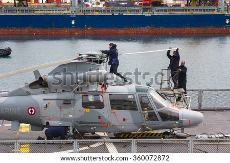 Odesa, UKRAINE - MARCH, 26, 2015: Workers assemble the blades of helicopter - stock photo