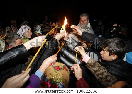 ODESSA - APRIL 14: The pilgrims brought the Holy Fire ritual of the temple of the Holy Sepulcher (in Jerusalem, Israel) on the Saturday before Easter in Odessa, Ukraine, April 14, 2012.