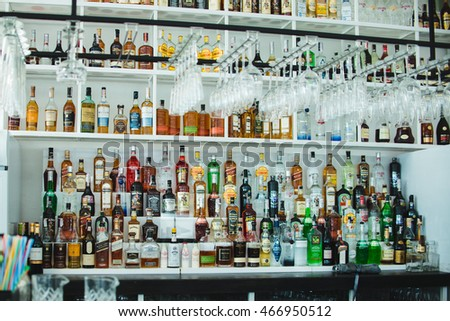 ODESSA, UA - 27 MAY 16: Ukraine summer 2016 terrace cafe street light bar with white interior bottles with alcohol and glasses on the bar counter
