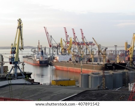 Odessa, Ukraine - April 13, 2016 Cargo cranes and ships Cargo Terminal sea port of Odessa in the sunset light.