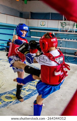 Odessa, Ukraine, April 26, 2015: Cup of Ukraine. Thai boxing among children. Kids boxing, kickboxing children. Children fight with these adult emotions. Popularization of sports and healthy lifestyle