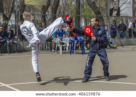 ODESSA, UKRAINE - April 9, 2016: Demonstrations of children for parents. Children, boys and girls are taking their first steps in learning the art of martial arts