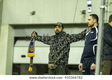 """ODESSA, UKRAINE - April 23, 2016: Football Team Super League champions """"Shakhtar"""" - Donetsk and """"Chernomorets"""" - Odessa. Fans in the stands Chernomorets show their support for the team during the game - stock photo"""