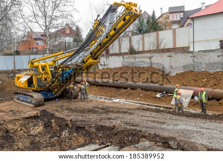ODESSA, UKRAINE - APRIL 2: Ukrainian construction workers pouring cement on the zero cycle of modern industrial cleaning sewer pipeline in Odessa, Ukraine April 2, 2014