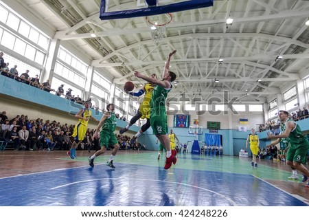 ODESSA, UKRAINE - April 2, 2016: Ukrainian Cup Basketball. Wrestling team leaders of Super League tournament. Derby BIPPA Odessa and Southern Chemist. Hard wrestling for the ball near the basket ring.