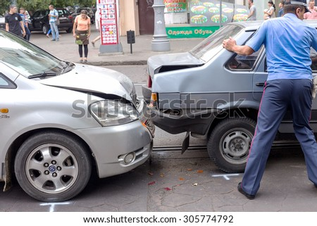 ODESSA, UKRAINE - August 13, 2015: A car accident in the city center. Fragment of an accident. Machinery behind crashed into each other. A typical problem of urban traffic - stock photo