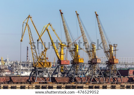 Odessa, Ukraine - August 17, 2010 Container cranes at the port container terminal. Industrial cargo ship loaded at the seaport. Loading operations. Sea trading port