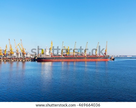 Odessa, Ukraine - August 15, 2016: Container cranes in cargo port terminal, cargo cranes without job in an empty harbor port. A crisis. Defaulted paralyzed entire economy