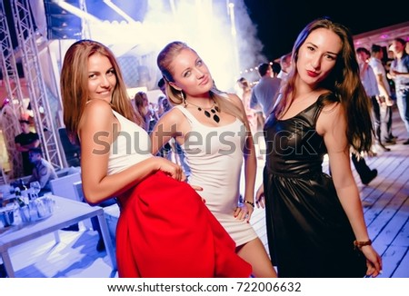 Odessa, ukraine August 8, 2015: Ibiza night club. People  smiling and posing on cam during concert in night club party. Man and woman have fun at club. Boy and girl at night club party