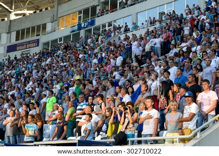 ODESSA, UKRAINE - August 2, 2015: The soccer fans and spectators in the stands of the stadium sick during futobolnogo match Dynamo Kiev - Chernomorets Odessa - stock photo