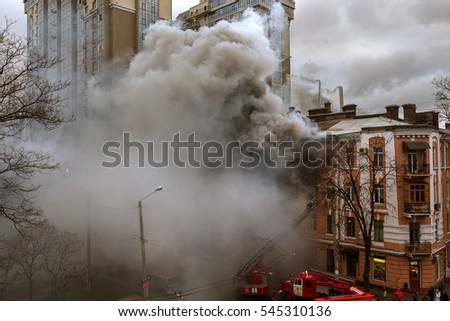 Odessa, Ukraine - December 29, 2016: A fire in apartment building. Strong bright light, Smoke clouds window of their burning house. Firefighters extinguish fire in house.