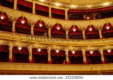 Odessa, Ukraine - December 11, 2012: The interior of the opera house after restoration. Spectators filled the place to the festive gala concert. Spectators at the pop jazz concert