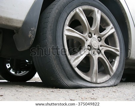 Odessa, Ukraine, February 10, 2016 -: breaking through the wheels of the car in the parking lot in the city center. - stock photo
