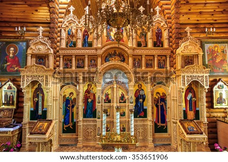 Odessa, Ukraine: Interior small wooden orthodox Christian church. Icons, holy relics, the iconostasis, the altar. The holy relics of saints canonized by the Christian in the ark - stock photo