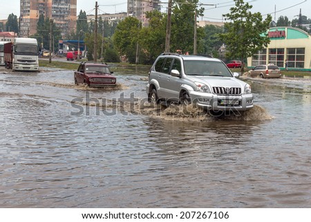 ODESSA, UKRAINE - July 24, 2014: As a result of heavy rainfall disaster flooded streets. Cars fording. Flooding. July 24, 2014 in Odessa, Ukraine
