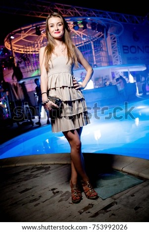 Odessa, Ukraine July 4, 2014: Bono beach club. Women smiling and posing on cam during concert in night club party. Girl have fun at club. girl at night club party