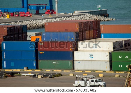 ODESSA, UKRAINE - July 14, 2017: Marine Industrial Commercial Port. Container terminal. Cargo container terminal of sea freight industrial port. Sea freight, container cranes. Industrial goods in port