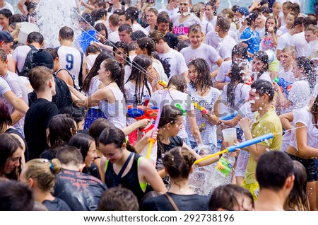 Odessa, Ukraine - 1 July 2015:  Openair water battle. Many happy people play pour water on each other celebrating festival