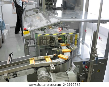ODESSA, UKRAINE - JULY 11: The modern factory production of pharmaceutical technologies. Pharmaceutical industry. Manufacturing. Conveyor production line of tablets, July 11, 2013 in Odessa, Ukraine - stock photo