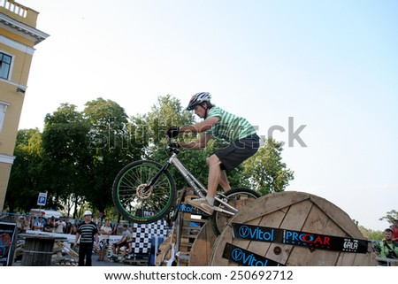 Odessa, Ukraine - July 28, 2007: Young male jumping freestyle and doing acrobatic tricks at a bike trial. BMX, MTB