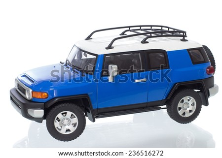 Odessa, Ukraine - 26 June 2014: Collectible toy car Toyota FJ Cruiser side view on a white background - stock photo