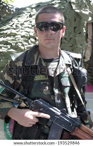 Odessa, Ukraine - June 15, 2011: Military exercises of Border Troops of Ukraine, a military sergeant in camouflage standing in office with arms June 15, 2011 in Odessa, Ukraine. - stock photo