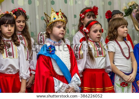 Odessa, Ukraine - March 4, 2016: children's music groups singing and dancing in celebration Women's Day. Mothers Day. Young children are congratulating on March 8. Emotional children's musical show.
