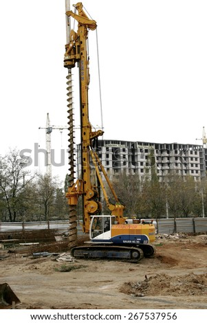 Odessa, Ukraine - November 3, 2008: Construction site. Research and setting the zero cycle, the foundation of a high-rise building. Construction rig for piling work and working in the trench - stock photo
