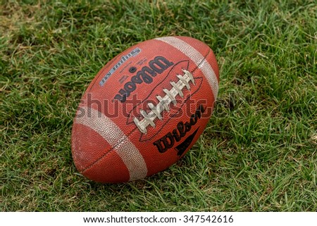 Odessa, Ukraine - November 7, 2015: Ukrainian Cup on American football PIRATES - Odessa and lions - Lions. Replacement ball for the game of football lying on the grass lawn. Sports tough sport.