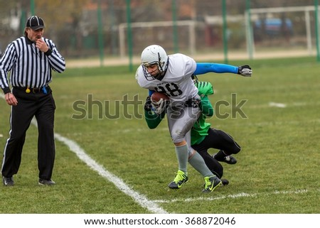 Odessa, Ukraine - November 7, 2015: Ukrainian Cup on American football PIRATES - Odessa and lions - Lions. Tense moment scrum during the match of men. Sport tough fight. - stock photo