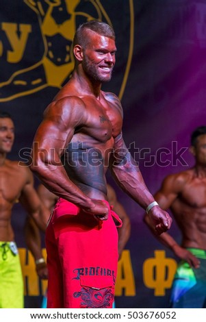 ODESSA, UKRAINE -23 October 2016: Athletes men participate in Championship of Ukraine on bodybuilding category? fitness and bodybuilding model. Beautiful athletic figure with big muscle men on stage