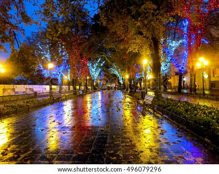 ODESSA, UKRAINE - October 4, 2016: Night city street lamps in the light of a rainy day. Creative blur. Dynamic city night scene of October 4, 2016 in Odessa