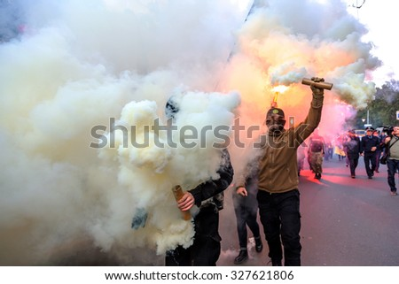 Odessa, Ukraine - October 14, 2015: Torchlight procession of radical extremists of left parties is accompanied by riots. Protesters, demonstrators carried a Nazi flag, burn fireworks and smoke bombs - stock photo