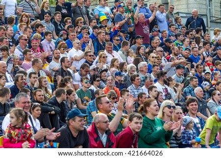 Odessa, Ukraine - sentyabryamaya 15, 2016: Spectators and fans in stands of the stadium during European Cup rugby. Moldova - Ukraine. Viewers react emotionally to umehi and losing teams in the game. - stock photo