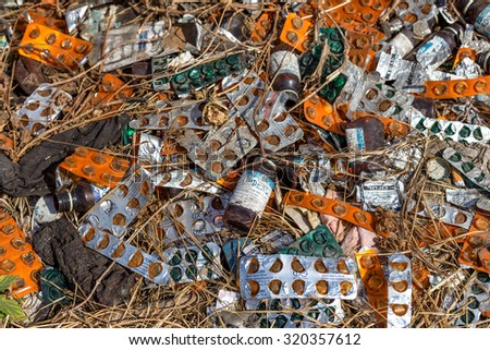 Odessa, Ukraine - September 12, 2015: A secret place of reception of narcotics addicts in an abandoned train station. Scattered empty packages of drugs and syringes in place of gathering of addicts.
