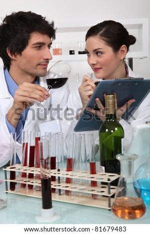 Oenologists analyzing a wine - stock photo