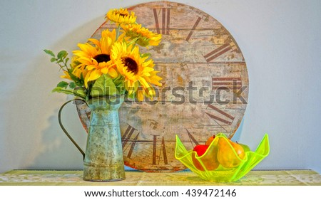Of clock, sunflowers, and fruits.