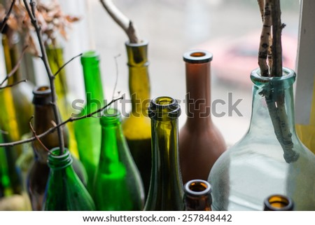 of glass bottles on the window - stock photo